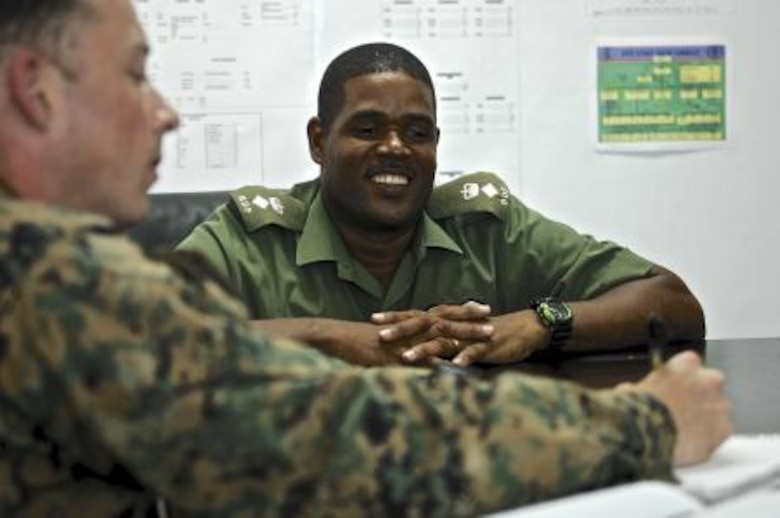 U.S. Marine Capt. Thomas Cahill, left, and U.S. Army Capt. Zulma Andrews, right, both civil affairs, share a laugh with Belize Defense Force Chief of Staff Lt. Col. Raymond Shepherd, center, during a key leader engagement May 6, 2013, at Price Barracks, Belize. The civil affairs team meets with key leaders and local communities to assess host-nation capabilities as part of an exercise known as New Horizons. New Horizons is a training exercise providing medical and dental treatment as well as constructs needed structures, such as classrooms, throughout Belize. It gives U.S., Belizean and Canadian service members the opportunity to train side-by-side in an exercise setting in order to be prepared to meet future challenges. (U.S. Air Force photo/Master Sgt. James Law)
