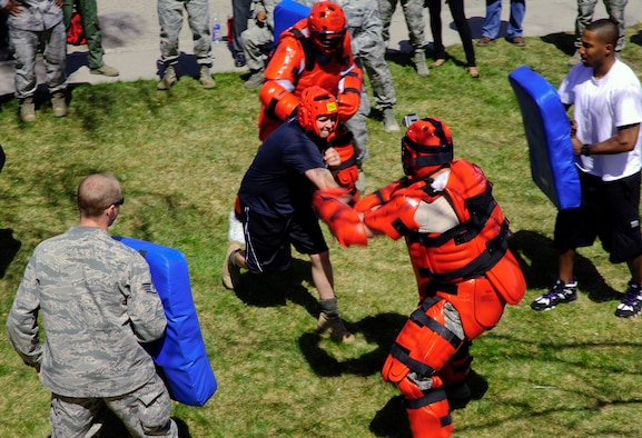 "Master Sgt. Ryan Glosson, 366th Security Forces Squadron first sergeant, faces fellow Defenders wearing 'Red Man' suits and earned a security forces beret after completing grueling physical tasks April 16, 2013. Maj. Ryan Bodge, 366th SFS commander, said, ""This isn't as much about the beret as it is about the symbol of the beret and the people in the unit who know, love and respect you."" (U.S. Air Force photo by Master Sgt. Kevin Wallace/RELEASED)"