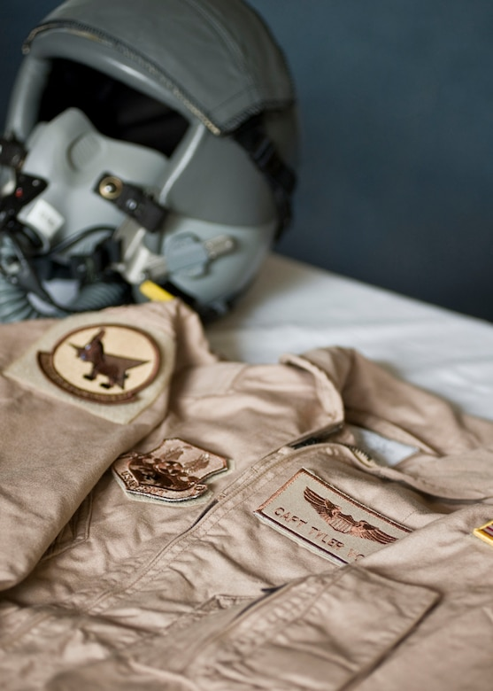 "A flight suit is displayed in honor of Capt. Mark ""Tyler"" Voss during a memorial service May 9, 2013, at Transit Center at Manas, Kyrgyzstan. Voss was a 22nd Expeditionary Air Refueling Squadron KC-135 Stratotanker pilot who perished in an aircraft accident on May 3, 2013. He was deployed from Fairchild Air Force Base, Wash., and was a native of Boerne, Texas. (U.S. Air Force photo/Staff Sgt. Stephanie Rubi)"