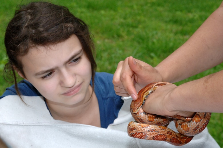 Park Ranger Amy Redmond shows a corn snake to a student from Hawkins Middle School during a presentation about snakes in Tennessee.  There were 11 learning stations that kids rotated between on Environmental Awareness Day at Old Hickory Lake.  The U.S. Army Corps of Engineers Nashville District sponsors events like this to draw awareness to subjects in science, technology, engineering and mathematics.