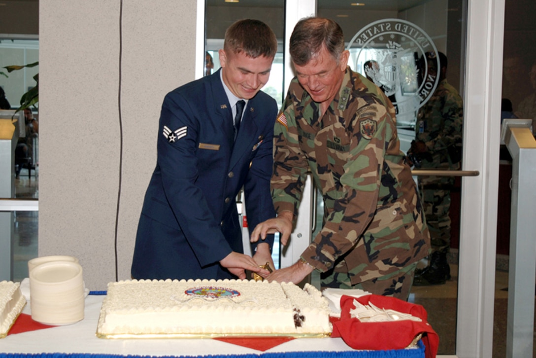 USNORTHCOM Deputy Commander Army Lt. Gen. Joseph Inge and Air Force Senior Airman Andrew Roberts, 22, the youngest military member assigned to the command, cut the ceremonial caked during the command's third anniversary celebration Sept. 30.