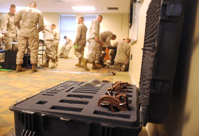 Marines turn in their tests after a chaser course at Yale Hall aboard Marine Corps Base Quantico, on May 6, 2013. Marines practiced using restraints as part of their training.