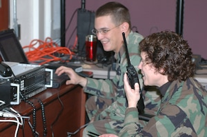 Col. Babette Lenfant works with Staff Sgt. Ethan Mabry during the Defense Interoperability Communications Exercise 06 to test a system that can tie together several different types of communications systems. DICE06 took place at Joint Task Force Civil Support Headquarters on Fort Monroe, Va.
