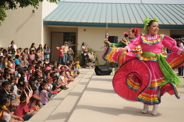 Marines from Marine Attack Squadron 211, based out of Marine Corps Air Station Yuma, watched their adopted students at George Carver Elementary school perform traditional Mexican heritage performances as part of their end of the school year Cinco De Mayo bash, May 3. Teachers joined in on one of the performances that they've been choreographing with the students for several weeks.
