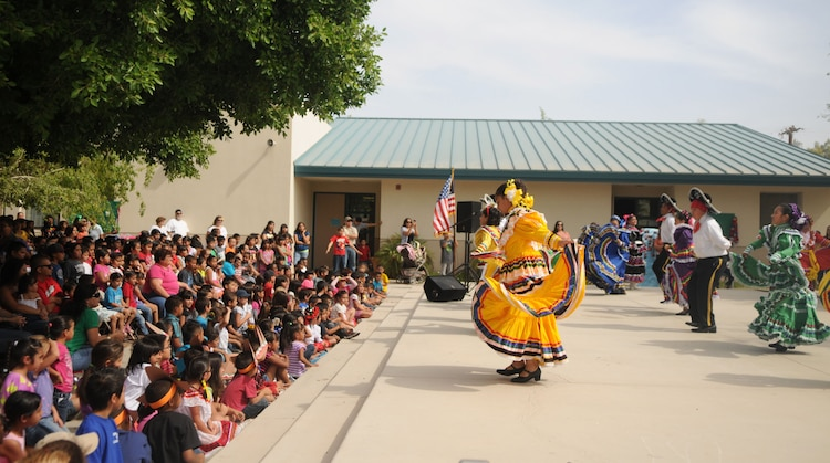 Marines from Marine Attack Squadron 211, based out of Marine Corps Air Station Yuma, watched their adopted students at George Carver Elementary school perform traditional Mexican heritage performances as part of their end of the school year Cinco De Mayo bash, May 3. The students wore intricate, colorful floral dresses and performed traditional dance sequences in front of a crowd of faculty, family, friends, and their Marine mentors.