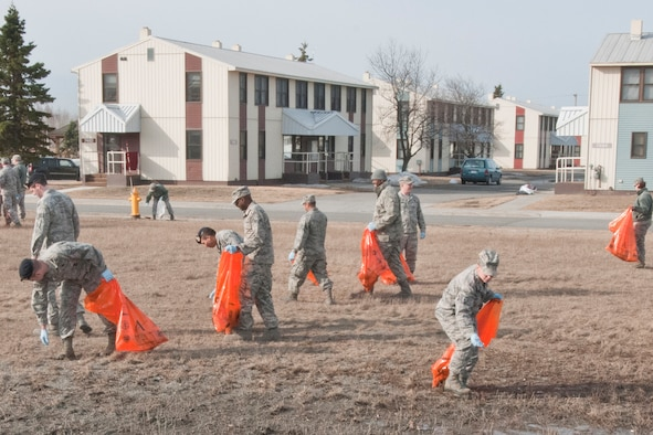 JOINT BASE ELMENDORF-RICHARDSON, Alaska -- 176 Wing members clean around their work building May 6 as part of the base's Spring Cleanup. Air guardsmen of all ranks helped in the effort.  National Guard photo by Staff Sgt. N. Alicia Goldberger.