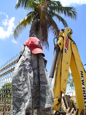An Airman's uniform blouse hangs on a fence at the construction site of Crooked Tree Government Primary School in Belize. (U.S. Air Force photo/Senior Master Sgt. Joel Shepherd)