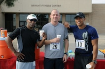 (From left to right) Eusevio Quinones, retired Navy, Tech. Sgt. Robert Amrich, 56th Component Maintenance Squadron section chief, and Maj. Siddig Mirghani, 56th AMDS public health flight commander, rehydrate after finishing the half marathon run May 4, in front of the Bryant Fitness Center at Luke Air Force Base. They were the three fastest men in the half marathon run, completing the first event for the Luke May Fitnesss Month. (U.S. Air Force photo/Airman 1st Class Pedro Mota)