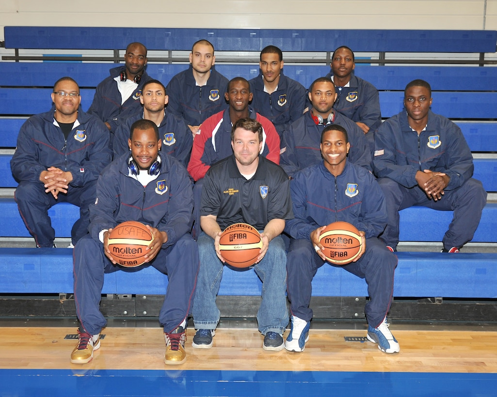 Airmen from the United States Air Forces in Europe men's basketball team pose for a group photo during their last training day May 9, 2013, at the gymnasium on RAF Lakenheath, England. The men's and women's teams are comprised of both officers and enlisted Airmen from various bases in USAFE chosen to represent the command in this year's Inter-Nation Sports Championship games. (U.S. Air Force photo by Senior Airman Jerilyn Quintanilla/Released)