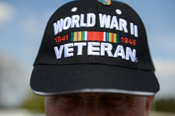 SPANGDAHLEM AIR BASE, Germany – A World War II veteran hat rests on the head of John Hobson during a memorial ceremony at the Henri-Chapelle American Cemetery and Memorial in Belgium May 6, 2013. Hobson fought in the war and now travels through the land where his comrades lay almost 70 years ago. The ceremony was part of a tour through Europe retracing the battlefield campaign of the 104th Infantry Division. (U.S. Air Force photo by Airman 1st Class Gustavo Castillo/Released)