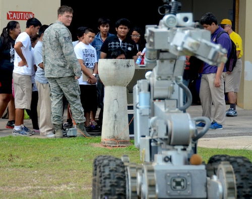 George Washington High School students take turns operating a F6A explosive ordnance disposal robot during a field trip to the EOD complex on Andersen Air Force Base, Guam, May 1, 2013. Forty-Three students took a field trip to the complex as part of their current history curriculum in World War II history and the Pacific Islands. (U.S. Air Force photo by Staff Sgt. Benjamin Wiseman/Released)