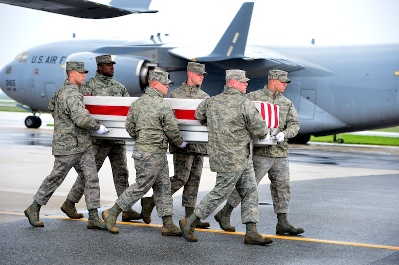 A U.S. Air Force carry team transfers the remains of Air Force Capt. Victoria A. Pinckney of Palmdale, Calif., at Dover Air Force Base, Del., May 11, 2013. Pinckney was assigned to the 93rd Air Refueling Squadron at Fairchild Air Force Base, Wash. (U.S. Air Force photo/David Tucker)