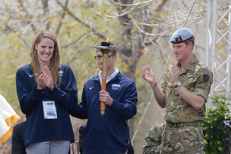 Olympian Missy Franklin, paralympian gold medal winner Navy Lt. Bradley Snyder and Prince Harry prepare to light the official torch to begin the 2013 Warrior Games at the U.S. Olympic Training Center in Colorado Springs, Colo., May 11, 2013. From May 11-16, more than 200 wounded, ill and injured servicemembers and veterans from the U.S. Marines, Army, Air Force and Navy, as well as a team representing U.S. Special Operations Command and an international team representing the United Kingdom, will compete for the gold in track and field, shooting, swimming, cycling, archery, wheelchair basketball and sitting volleyball at the U.S. Olympic Training Center and U.S. Air Force Academy. The military service with the most medals will win the Chairman's Cup.  (DoD photo/EJ Hersom)