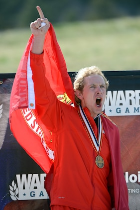 Marine Sgt. Brian McPherson reacts to winning gold in the Men's Bicyle Open event of the 2013 Warrior Games in Colorado Springs, Colo., May 12.