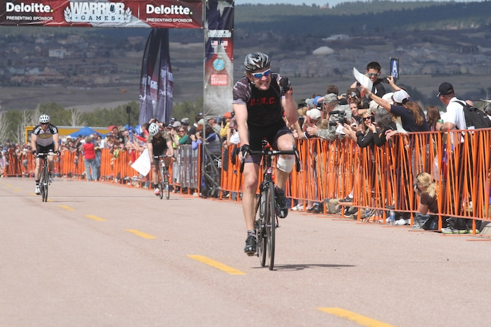 Marine veteran Sgt. Brian McPherson cheers as he crossed the finish line earning a gold medal in the open bracket upright race. McPherson, 32, from Theodore, Ala., sustained injuries from an improvised explosive device and small arms fire in Afghanistan.