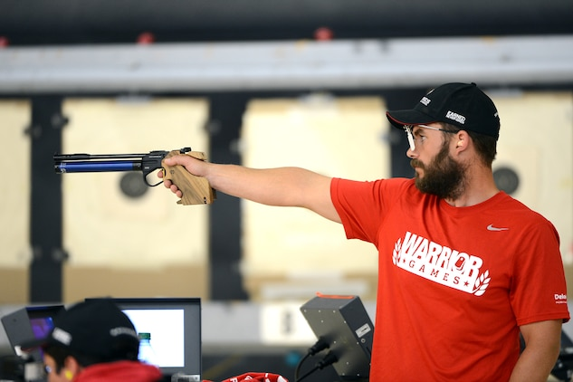 Retired Marine Capt. Richard Rush fires a shot in the 10mm air pistol event of the 2013 Warrior Games in Colorado Springs, Colo. May 13, 2013.