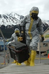 SEWARD, Alaska Ð Members of the National Guard's civil support team board the USNS Henry J. Kaiser in biohazard suits here May 11 to investigate a simulated report of suspicious chemicals aboard during an exercise scenario for Alaska Shield/Northern Edge 2007.  The civil support team worked in conjunction with the Seward police and fire departments, the Coast Guard, the FBI, and many other organizations to practice interagency coordination in an emergency situation.  AKS/NE 07 is a State of Alaska/US NORTHCOM sponsored homeland defense/defense support of civil authorities exercise; part of the national-level Ardent Sentry/Northern Edge 07.  U.S. Navy photo by Mass Communication Specialist 1st Class Daniel N. Woods