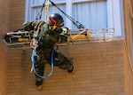CAMP MUSCATATUCK URBAN TRAINING CENTER, Ind.— An unidentified member of the Marine Corps' Chemical Biological Incident Force, casualty extraction team, looks down to ensure there are no obstructions as he repels down the front of a building from the roof of a four story building with a victim during the Ardent Exercise here with a dummy as a simulated victim.
