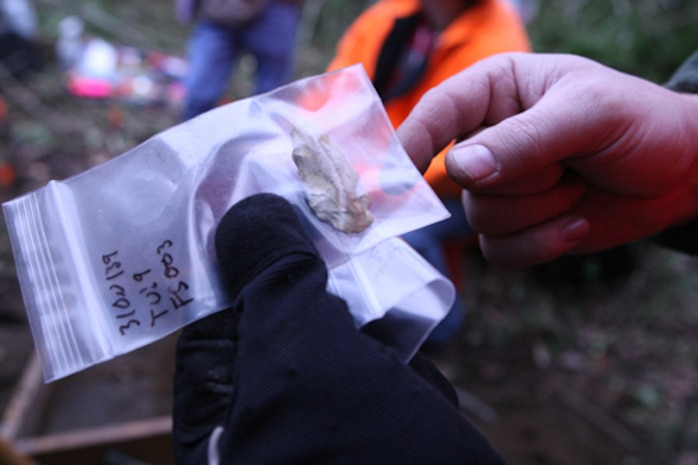 This is one of the artifacts recovered from an archaeology site on MCB Camp Lejeune. Archaeologists carefully note where each artifact comes from in order to better understand the site and context. Photograph by Lance Cpl. Nikki S. Phongsisattanak