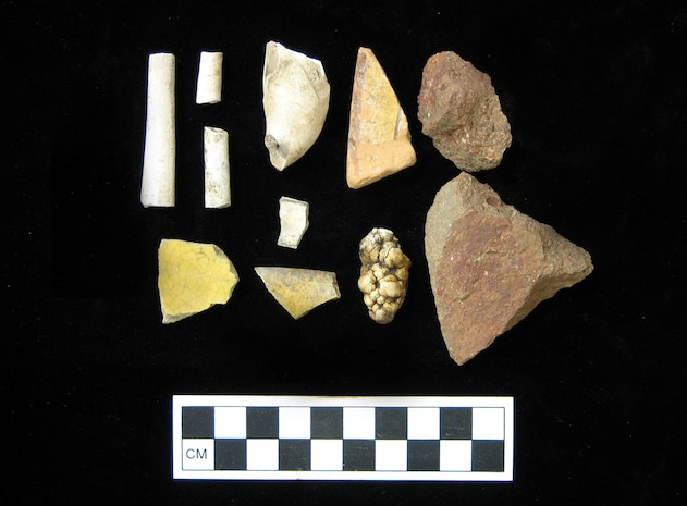 Many types of artifacts are found at MCB Camp Lejeune. These are all historic artifacts recovered from an archaeology site on the base, such as kaolin pipe fragments and ceramics.