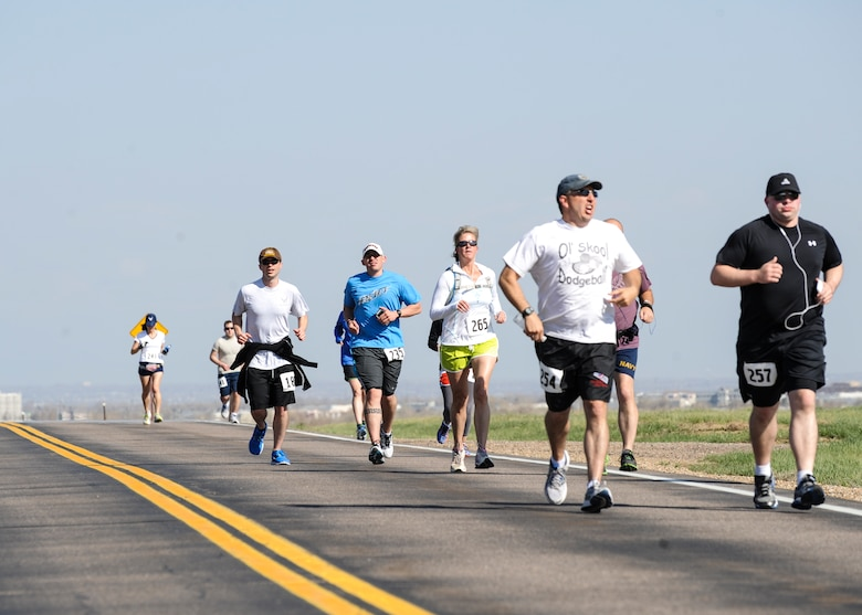 Runners finish the first of 13.1 miles during the 7th Annual Buckley Half Marathon May 11, 2013, on Buckley Air Force Base, Colo. About 50 runners participated in the run. (U.S. Air Force photo by Staff Sgt. Christopher Gross/Released)