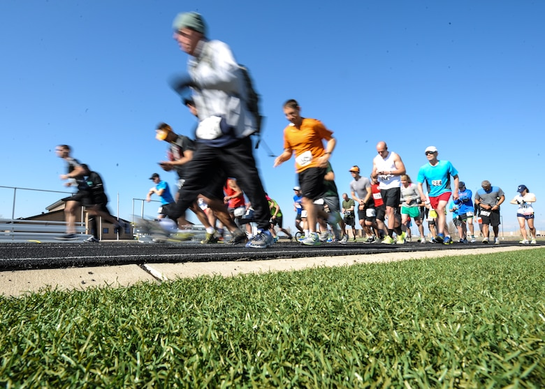 Buckley half marathon runners start their journey May 11, 2013, on the track at Buckley Air Force Base, Colo. About 50 runners participated in the 7th Annual Buckley Half Marathon. The Buckley Fitness Center organized several different endurance events leading up to the race. (U.S. Air Force photo by Staff Sgt. Christopher Gross/Released)