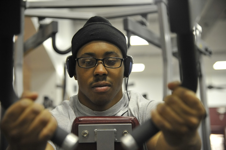 Senior Airman Adrian Paisley, 509th FSS fitness specialist, pulls on pull-down bars at the fitness center on Whiteman Air Force Base, April 22, 2013. Setting a daily routine is an excellent way to maintain good fitness and health. Relieving stress and getting fit can play a vital role in overcoming every day endeavors. (U.S. Air Force photo by Airman 1st Class Keenan Berry/Released)