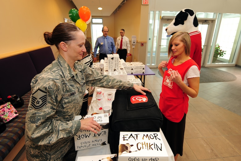 U.S. Air Force Master Sgt. Amanda Limmer, 343rd Recruiting Squadron, gives a Chick-fil-A boxed lunch to Nikkoll Wilkens, an older infant teacher with the Child Daycare Center, as part of Daycare Provider Day catered by Chick-fil-A on May 8 at Offutt Air Force Base, Neb.  Chick-fil-A donated 154 prepared meals to Offutt daycare providers at both CDC locations.  (U.S. Air Force photo by Josh Plueger/Released)