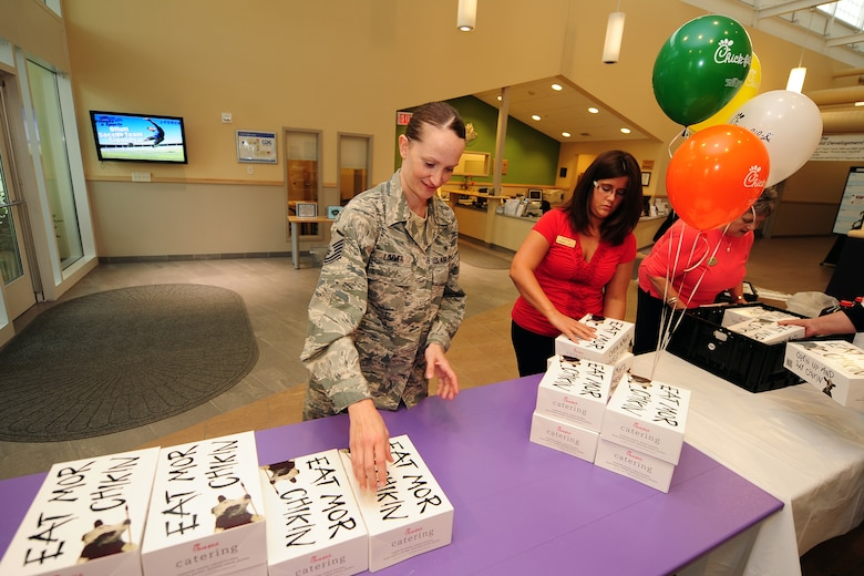 U.S. Air Force Master Sgt. Amanda Limmer, 343rd Recruiting Squadron, stacks 77 Chick-fil-A lunch boxes that were donated as a way to say thank you for the employees of the two Child Daycare Centers on May 8 at Offutt Air Force Base, Neb.  A total of 154 meals were provided by Chick-fil-A.  (U.S. Air Force photo by Josh Plueger/Released)