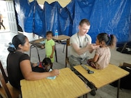 Capt. Charles Pace, 42nd Medical group pediatrician, attends to patients during the New Horizons mission to Belize, April 17.In the two-week trip, the group of 30 treated approximately 7,000 patients in five different locations within Belize. (Submitted photo)