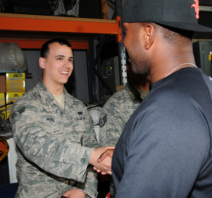 From left, Senior Airman Jerimiah Perou, 100th Security Forces Squadron member from Fort Collins, Colo., greets Airman 1st Class Christopher Simmons, 100th SFS response force member from Greensboro, N.C., as he returns to RAF Mildenhall, England, from a six-month deployment May 10, 2013, in support of Operation Enduring Freedom. Service members from the 100th SFS returned home to their friends and families May 9 to 11. (U.S. Air Force photo by Karen Abeyasekere/Released)
