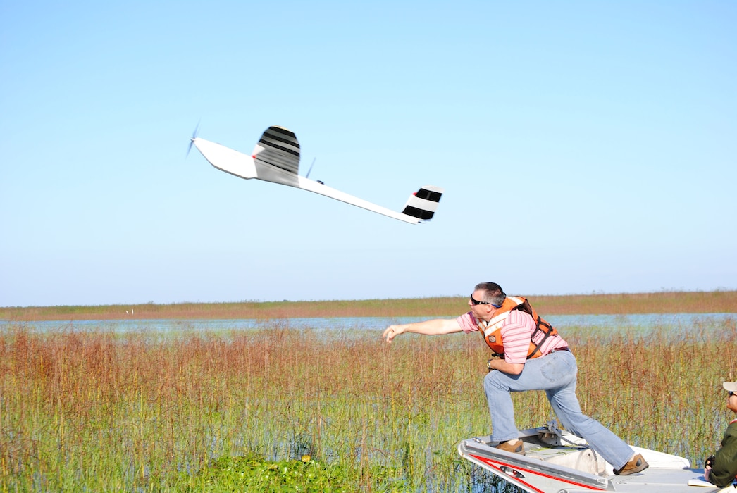 With a mighty heave, Damon Wolfe, geodesist with Jacksonville District, launches the NOVA Unmanned Arial Vehicle (UAV) on a flight over Lake Okeechobee.  The Corps used photos from the UAV to track the progress of various plant species at the lake.