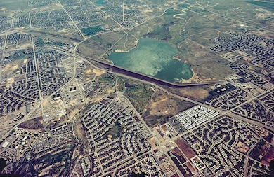 Cherry Creek Lake lies on Cherry Creek at its confluence with Cottonwood Creek, at the southeast edge of Denver. The lake is 3.25 miles long and has an average depth of 46 feet. The lake drains an area of approximately 390 square miles. The 850-surface-acre lake has a storage capacity of 13,960 acre-feet.