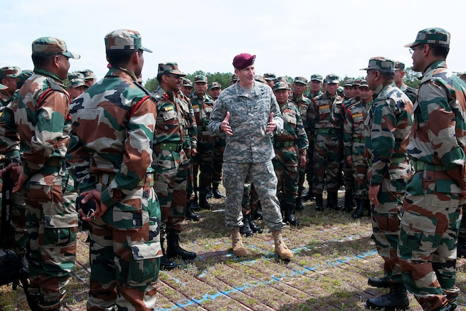 U.S. Army Maj. Gen. John W. Nicholson, center, commanding general of the 82nd Airborne Division, welcomes Indian army troops assigned to the 99th Mountain Brigade, the 50th Independent Para Brigade, and supporting elements to Yudh Abhyas 2013 on Fort Bragg, N.C., May 3, 2013.