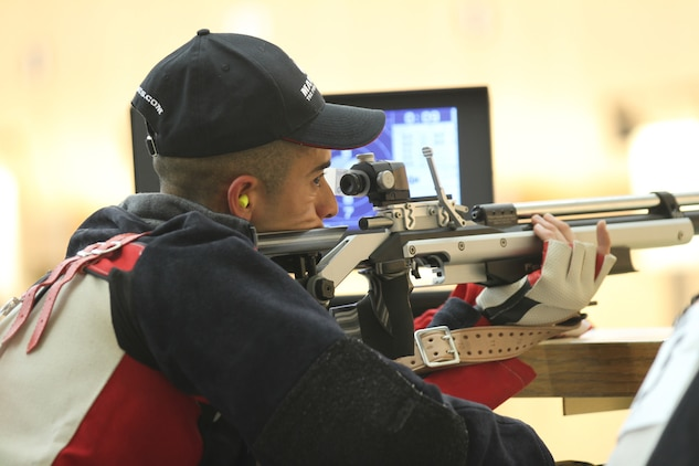 Sgt. Jorge Toledo, 30, from Miami, Fla., and currently assigned to Wounded Warrior Battalion West, fires his air rifle during the permanent disability shooting competition at the 2013 Warrior Games at the U.S. Olympic Training Center in Colorado Springs, Colo., May 13.