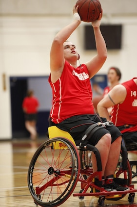 Zach Blair, Marine Corps Wheel Chair Basketball team, shoots during the 2013 Warrior Games at the Olympic Training Facility, Colorado Springs, Colo., May 12. Kimberly Blair, prior service Marine Corps segeant and Zach's mother, was present for his events.