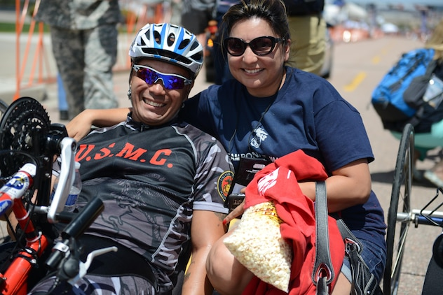 Marine Staff Sgt. Ronnie Jimenez celebrates his 10K handcycling win at the 2013 Warrior Games with his wife, Patrice, shortly after crossing the finish line, May 13. His time was 21:53, earning him the gold medal and motivating his Marine team.