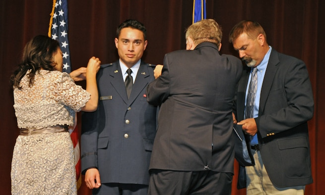 SAN ANGELO, Texas - 2nd Lt. Kenneth Chalupa, former Angelo State University Air Force ROTC Detachment 847 cadet, receives his second lieutenant bars during a ROTC commissioning ceremony at ASU Houston Harte University Center here, May 10. Chalupa chose to have his mother, stepfather and grandfather pin on his rank. (U.S. Air Force photo/ Airman 1st Class Joshua Edwards)