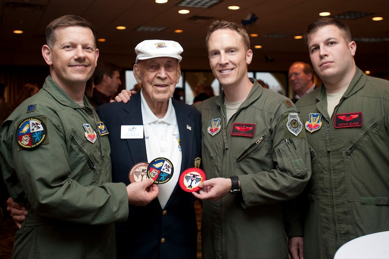 (Left to right) Lt. Col. John Martin, 28th Operations Group deputy commander, Lt. Col. Dick Cole, retired, Doolittle Raider co-pilot crew 1, Maj. Donavon Davis, 34th Bomb Squadron and 1st Lt. Arman Olgun, 34th Bomb Squadron, pose for a photo during a reception, April 19, 2013. Martin, Davis and Arman are from Ellsworth Air Force Base, SD and are part of the present Doolittle Raiders. (U.S. Air Force Photo by Senior Airman Carlin Leslie)