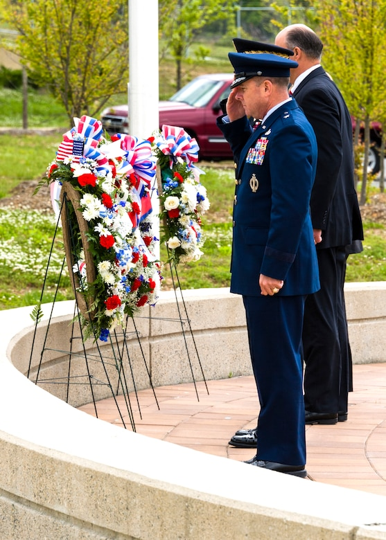 Brig. Gen. Kevin J. Jacobsen, OSI commander, and leadership representatives from the Naval Criminal Investigative Service, the Defense Security Service and the U.S. Army Criminal Investigation Command, pay their respects to the wreaths displayed in honor of each agency's members who died in the line of duty. The ceremony was held May 13 at the Russell Knox Building at Quantico, Va. (U.S. Air Force photo/Mr. Mike Hastings)