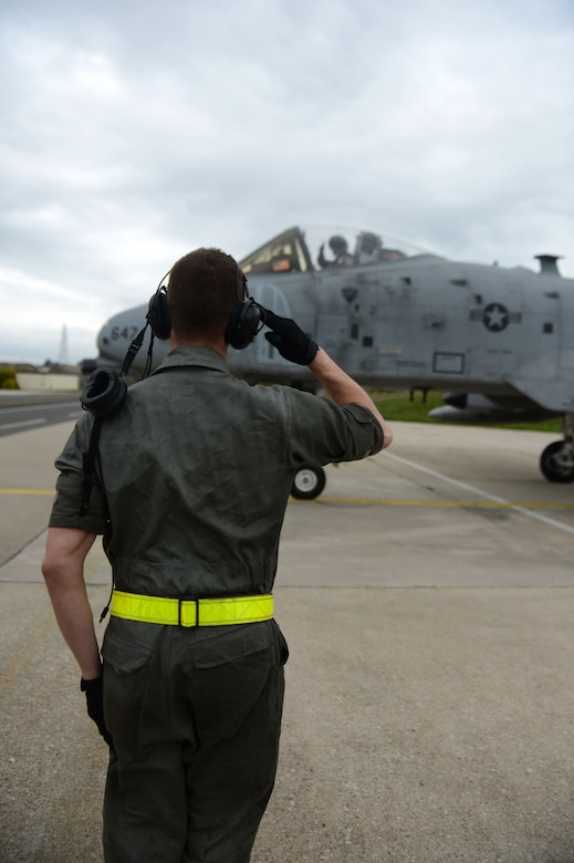 SPANGDAHLEM AIR BASE, Germany – U.S. Air Force Airman 1st Class Ethan Du Barton, 52nd Aircraft Maintenance Squadron crew chief from Kingman, Ariz., salutes U.S. Air Force Capt. Gregory Ulrich, 81st Fighter Squadron pilot from Fairfield, Calif. as he takes part in the final A-10 Thunderbolt II tactical sortie May 14, 2013. Flying hours across the Air Force are being reduced; however, pilots strive to maintain their proficiency by training at every opportunity. (U.S. Air Force photo by Airman 1st Class Gustavo Castillo/Released)