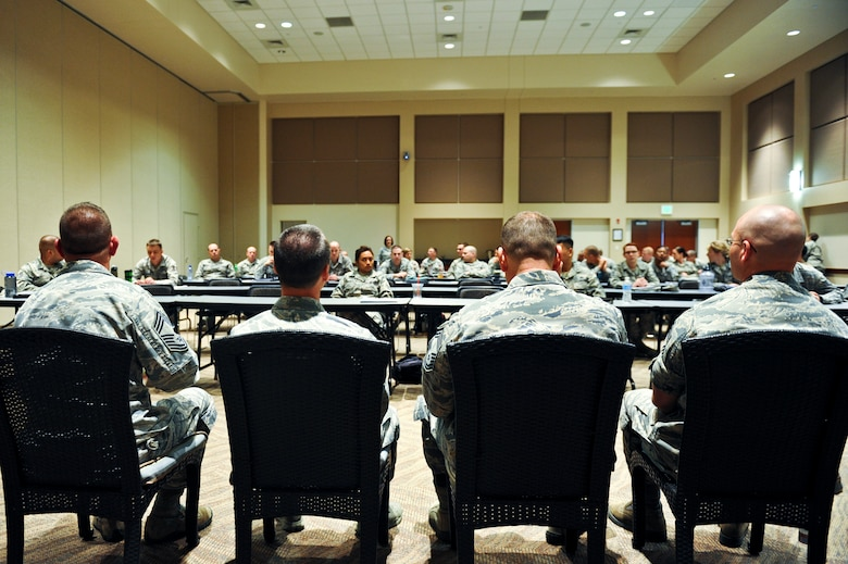 Four chief master sergeants answer questions from the participants of the week long additional-duty first sergeant symposium May 11, 2013, at the Leadership Development Center on Buckley Air Force Base, Colo. The chiefs shared their experiences relating to first sergeant duty and answered questions the new additional-duty first sergeants had concerning their new responsibilities. (U.S. Air Force photo by Airman 1st Class Riley Johnson/Released)