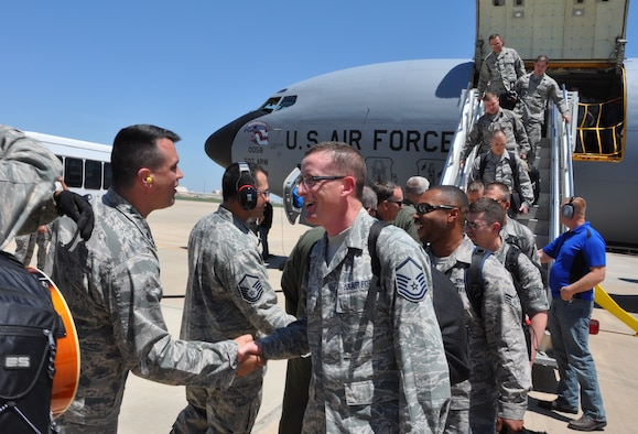 Lt. Col. Bradely Garcia, 507th Maintenace Squadron commander welcomes Master Sgt. Camerson Dinger, 507th MXS and 20 other Reservists that returned home from South West Asia here May 13. The 507th ARW Reservists served five months supporting on-going air refueling operations in U.S. Central Command area of responsibility. (U.S. Air Force photo by Maj. Jon Quinlan)