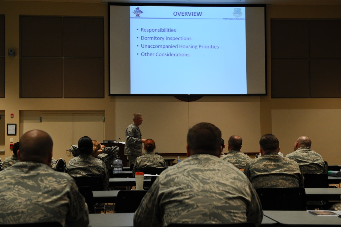 Additional-Duty First Sergeant Symposium participants listen to a lecture concerning dorm room inspections May 8, 2013, at the Leadership Development Center on Buckley Air Force Base, Colo. This training focused on the ability of a first sergeant to respond to a wide variety of scenarios not typically encountered as a supervisor. (U.S. Air Force photo by Senior Airman Phillip Houk/Released)