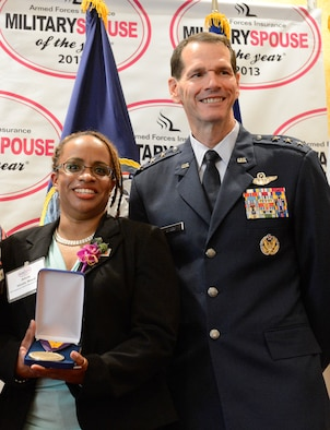 Alicia Hinds Ward, 2013 National Guard Spouse of the Year, poses for a photo with Lt. Gen. Stanley E. Clarke III, the director of the Air National Guard after winning the 2013 Military Spouse of the Year award, in Arlington, Va., May 9, 2013. The awards, presented by Military Spouse magazine and sponsored by Armed Forces Insurance, honor spouses of military members. (Air Force photo by Scott Ash)