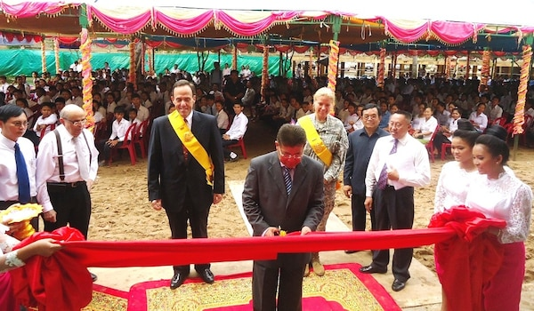 His Excellency Im Sethy, Cambodian Minister of Education, Youth and Sports, cuts a ribbon to celebrate the completion of Preah Ang Duong High School on April 23 in Prey Veng City, Cambodia.  Behind him from left are the Honorable William E. Todd, U.S. Ambassador to Cambodia, and Lt. Col. Kristin A. Means, Chief of the Office of Defense Cooperation for the U.S. Embassy in Cambodia.