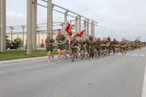 "Marine Aviation Logistics Squadron 26 goes for a camaraderie formation run May 3. The run was an opportunity for Lt. Col. Douglas Engel, MALS-26 commanding officer, to break bread and run with his marines before summer turnover. ""I wanted to take this opportunity to thank all of the Marines of MALS-26 for everything they do,"" said Engel. ""We have marines deployed wherever Marine Aircraft Group 26 has MV-22B Ospreys, and I wanted to take this opportunity to let all the marines know that their hard work does not go unrecognized."""