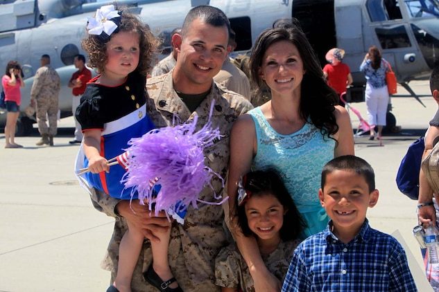 After and eight-month deployment, a Marine with Marine Medium Helicopter Squadron 364 (Reinforced), the aviation combat element for the 15th Marine Expeditionary Unit, reunites with his family during their homecoming at Camp Pendleton, May 13. While deployed, the Marines acted as a forward-deployed, sea-based Marine Air Ground Task Force capable of conducting a wide variety of operations from humanitarian assistance to combat related missions.