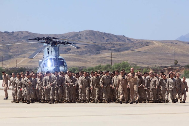 Marines with Marine Medium Helicopter Squadron 364 (Reinforced), the aviation combat element for the 15th Marine Expeditionary Unit, break after formation and make their way to their loved ones during their homecoming at Camp Pendleton, May 13.