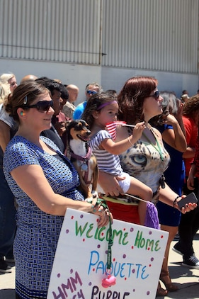 Family and friends of Marines and sailors with Marine Medium Helicopter Squadron 364 (Reinforced), the aviation combat element for the 15th Marine Expeditionary Unit, reunited with loved ones during a homecoming ceremony at Camp Pendleton, May 13.